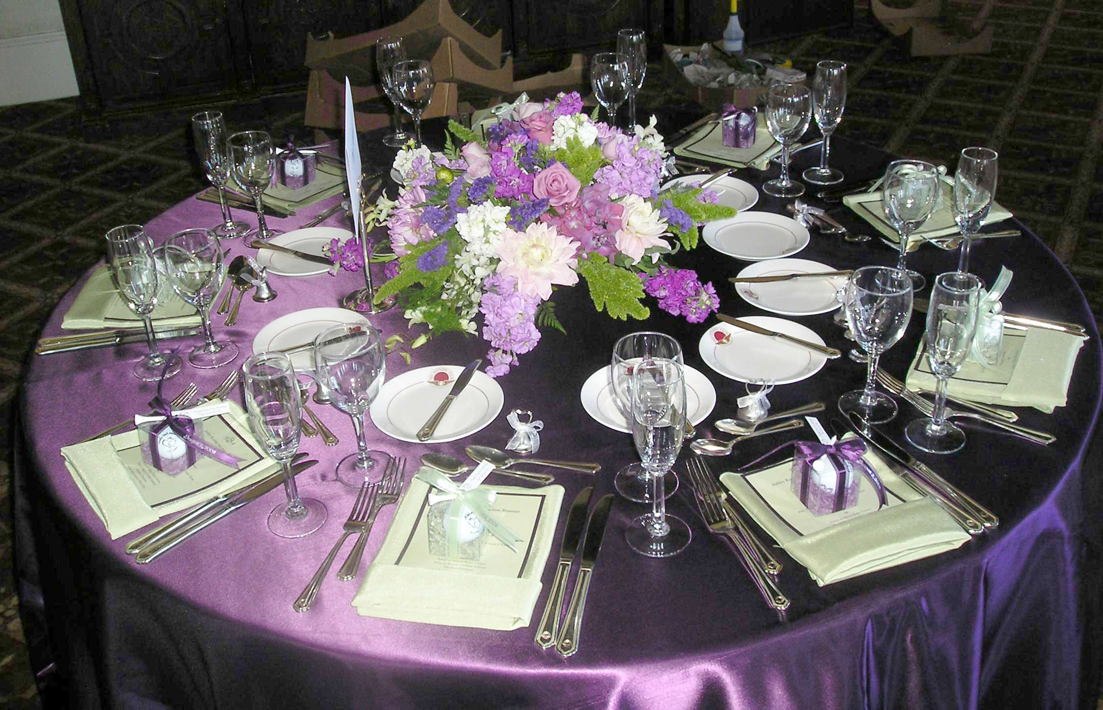 Reception Table Decorated In Purple By Hoogasian Flowers